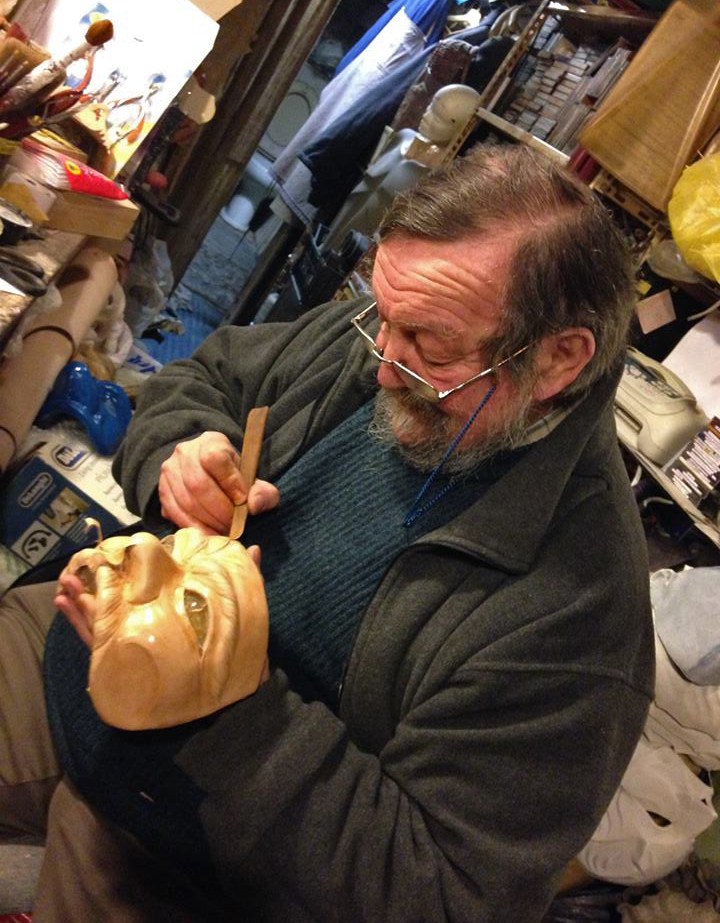 Carlo Setti in his workshop working on a leather mask for actors of the Commedia dell'Arte