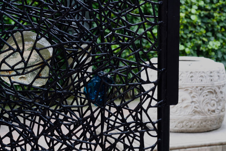 Gate in metal and Glass designed by Claire Falkenstein for the Peggy Guggenheim collection in Venice, Detail with wellhead