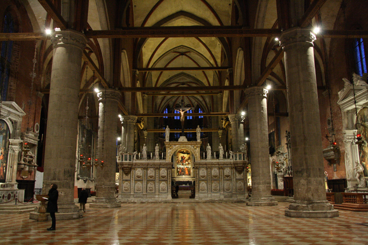 The Frari church, the main nave framing Titian's masterpiece, Venice