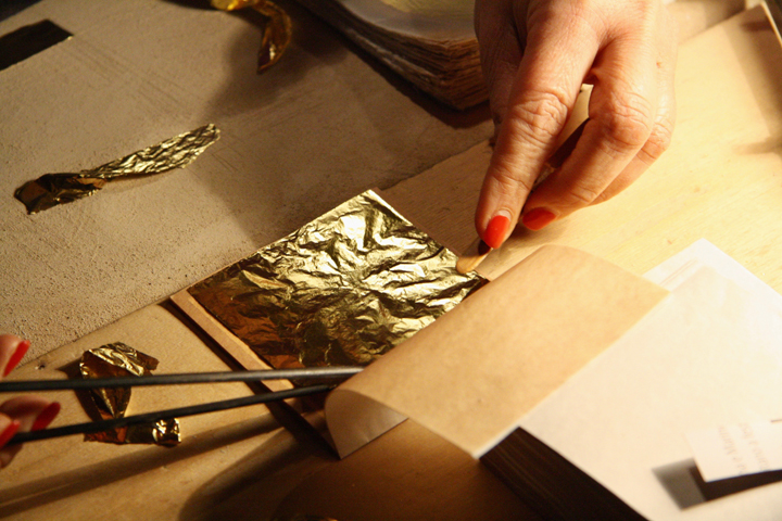 Placing gold leaf in between the paper foils
