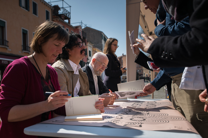 Kathleen Jamie, Mohamed Moksidi e Sergej Gandlevskij signing their books at the Incroci di Civiltà Gazebo in Campo Santa Margherita, Venice 2018 - credits by Venice Documentation Project