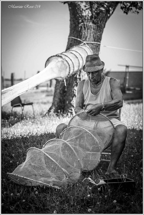 """Bepi Suste"" fixing the ""cogolo"" net in Burano - Venice, photo by Maurizio Rossi"