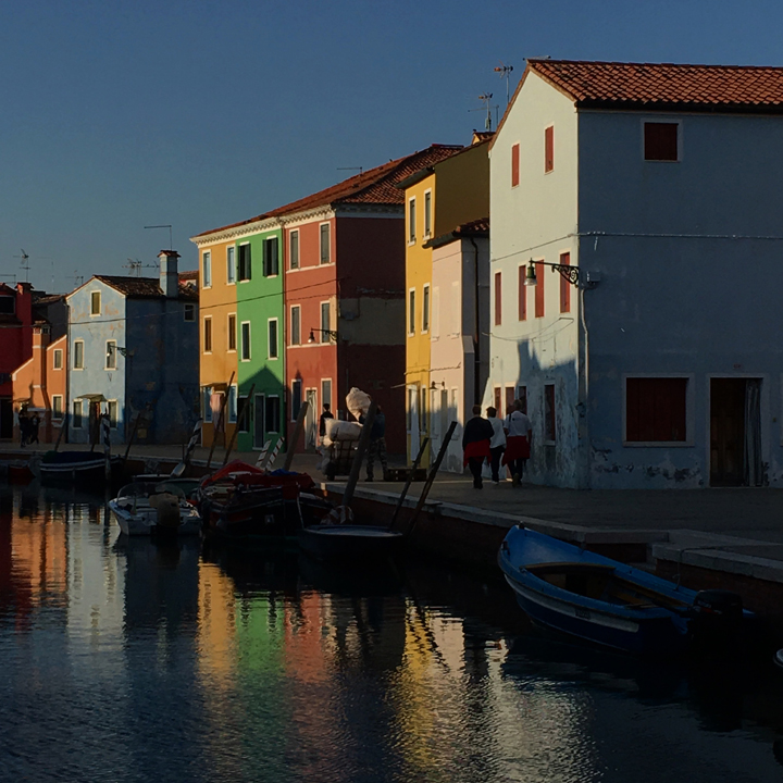The island of Burano by sunset with its colorful houses