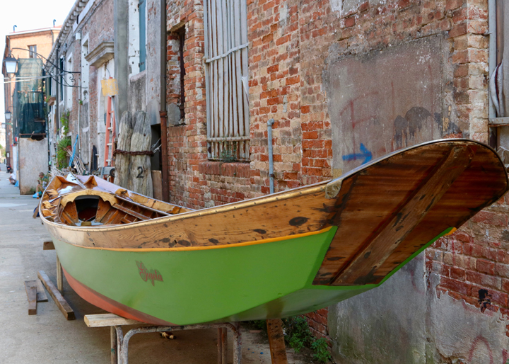 "A restored wooden ""sandolo"" outside the boatyard run by Venice On Board"