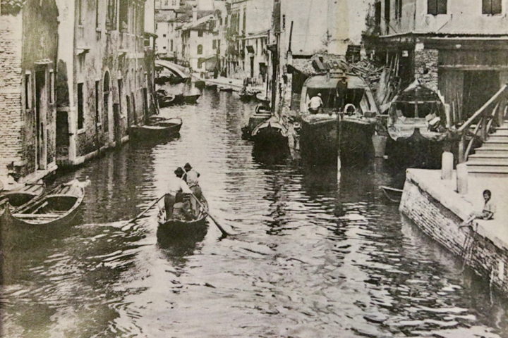 "An old photograph showing Venetians rowing by the ""squero"" in Cannaregio"