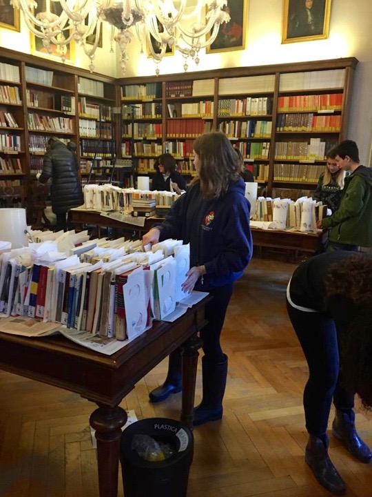 Young students at the Querini Stampalia library in Venice take care of the damaged books after the floods