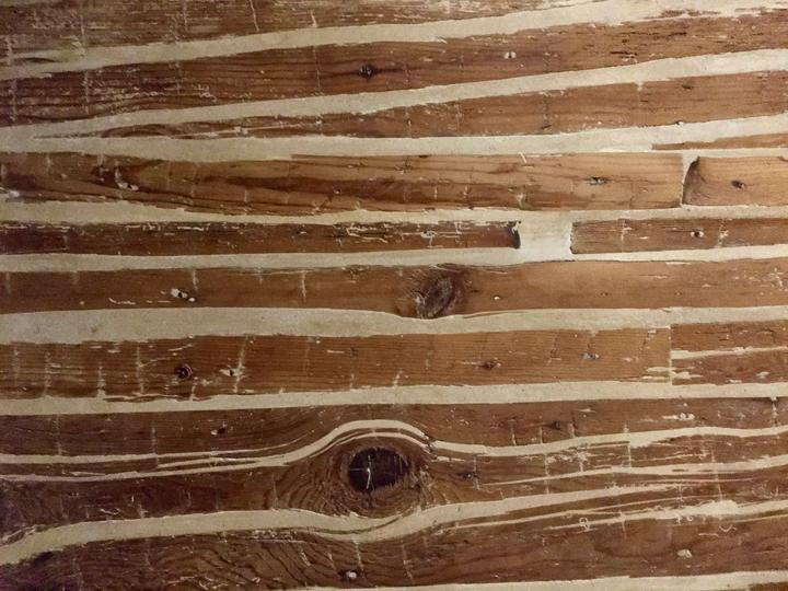 A wooden wall inside a Venetian house